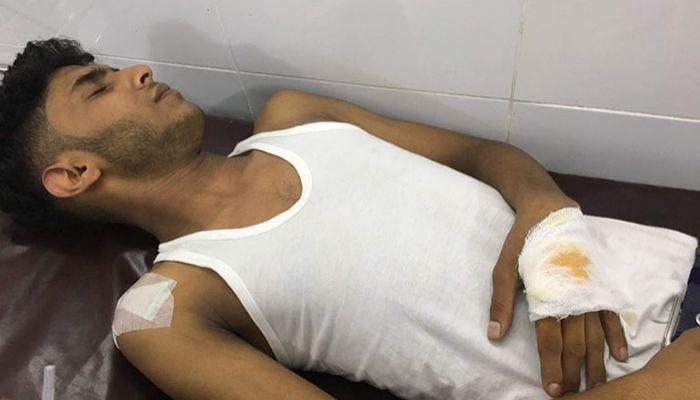 হামলায় আহত ইমন চৌধুরী। ছবি : নোয়াখালী প্রতিনিধি